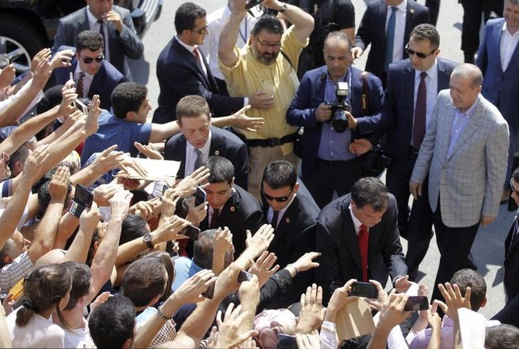 668991-pm-and-presidential-candidate-erdogan-walks-toward-crowd-after-he-voted-during-presidential-election