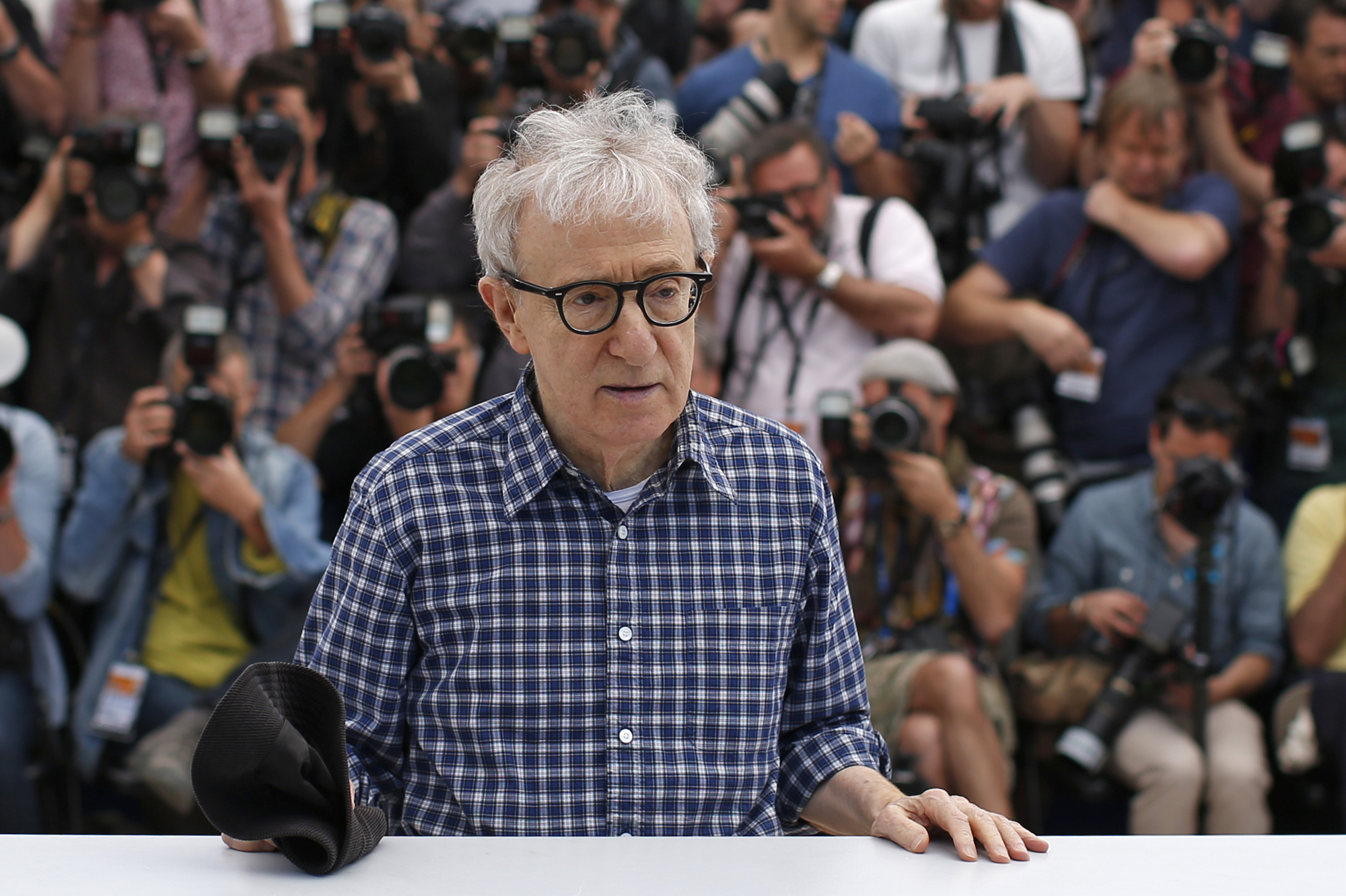 "Director Woody Allen poses during a photocall for the film ""Irrational Man"" out of competition at the 68th Cannes Film Festival in Cannes"