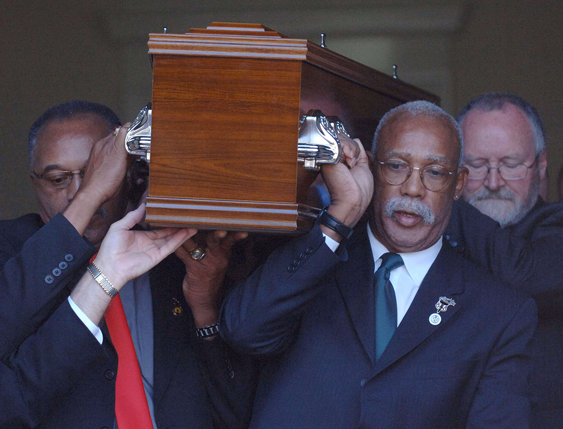 Tommie Smith, left, and John Carlos, 2nd right, who gave the historic black power salutes at the 1968 Olympics, have reunited for the final time with the third man on the podium that year as they as they act as pallbearers for Peter Norman at his funeral in Melbourne, Australia, Monday, Oct. 9, 2006. Smith and Carlos attended the funeral of Peter Norman, the Australian sprinter that won the silver medal in the 200 meters at the Mexico City Games who died last week of a heart attack at the age of 64. (AP Photo)/AUSTRALIA_NORMAN_