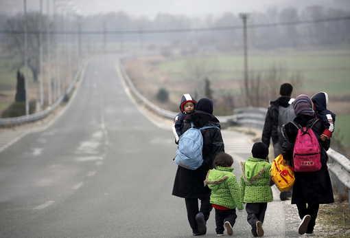 Réfugiés afghans près de la frontière entre Grèce et Macédoine • Crédits : Yannis Behrakis - Reuters