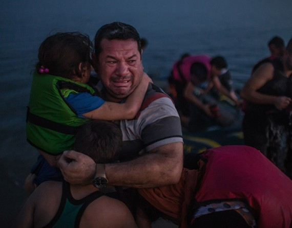 Laith Majid, an Iraqi, broke down in tears, holding his son and daughter after they arrived safely in Kos, Greece, on a flimsy rubber boat (The New York Times/Daniel Etter - August 15, 2015).