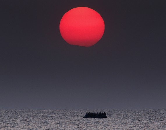 An overcrowded inflatable boat with Syrian refugees drifts in the Aegean sea between Turkey and Greece after its motor broke down off the Greek island of Kos. (Thomson Reuters/Yannis Behrakis - August 11, 2015)