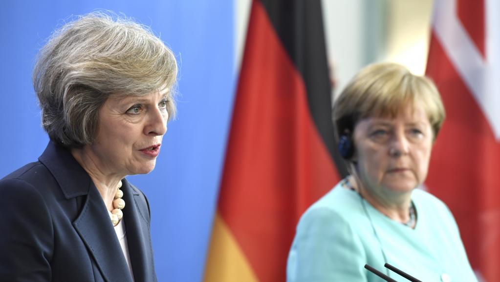 La Première ministre britannique Theresa May (à gauche) et la chancelière allemande Angela Merkel, le 20 juillet dernier à Berlin. John MACDOUGALL