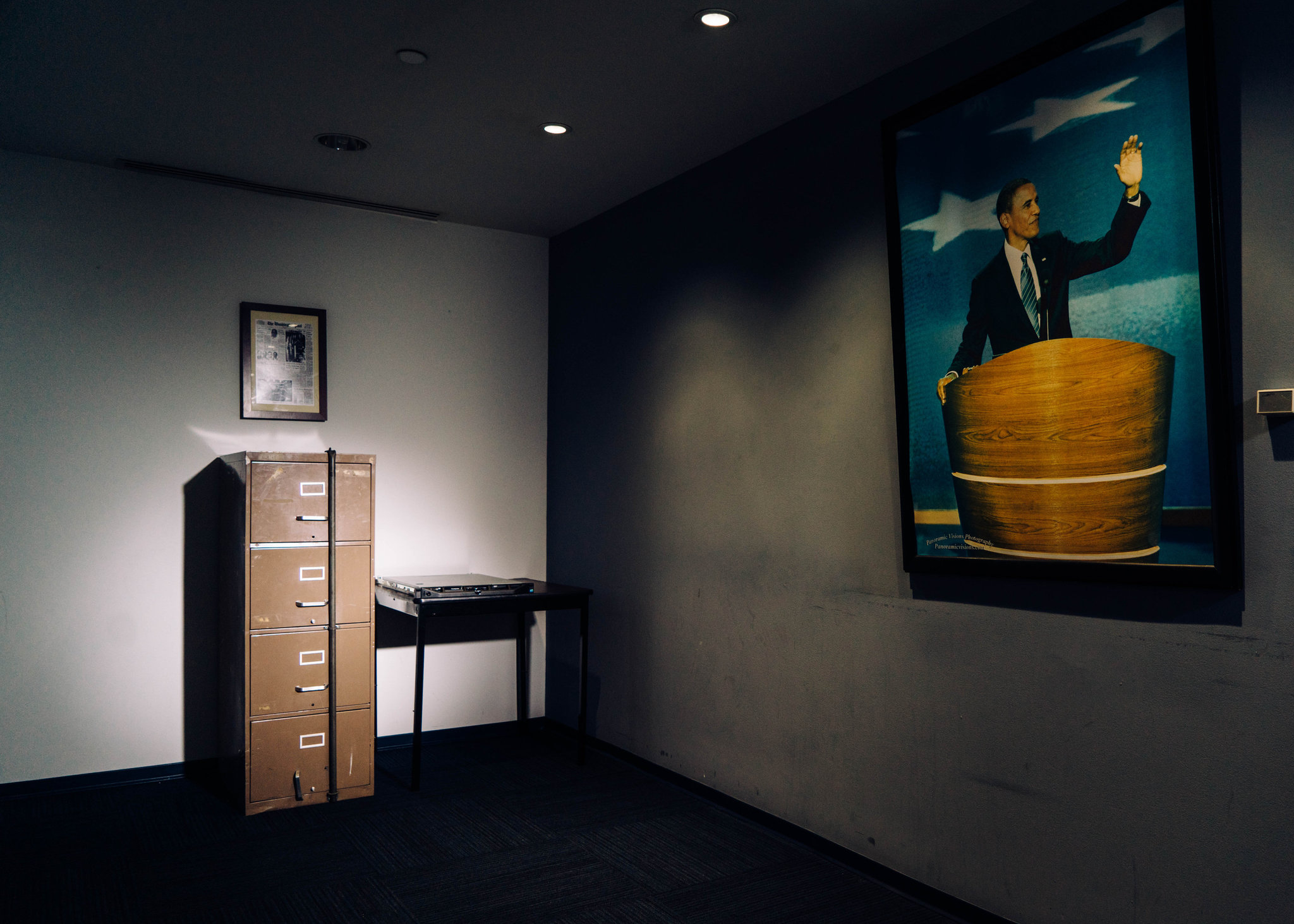 A filing cabinet broken into in 1972 as part of the Watergate burglary sits beside a computer server that Russian hackers breached during the 2016 presidential campaign at the Democratic National Committee's headquarters in Washington. Credit Justin T. Gellerson for The New York Times