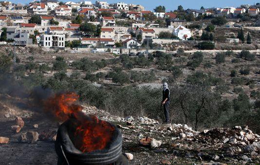 Lors d'une manifestation contre l'expropriation de terres palestiniennes par Israël dans le village de Kfar Qaddum, près de Naplouse, en Cisjordanie, le 9 décembre. Lors d'une manifestation contre l'expropriation de terres palestiniennes par Israël dans le village de Kfar Qaddum, près de Naplouse, en Cisjordanie, le 9 décembre. JAAFAR ASHTIYEH / AFP