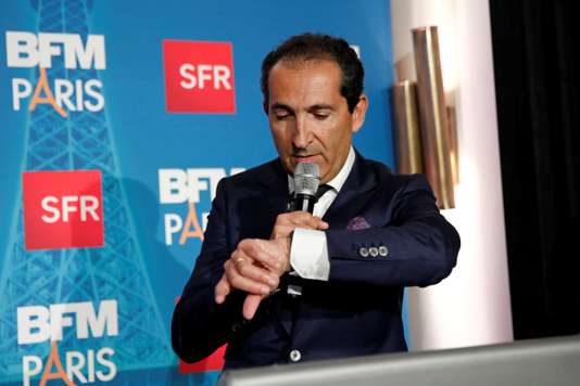 FILE PHOTO: Patrick Drahi, Franco-Israeli businessman and Executive Chairman of cable and mobile telecoms company Altice, speaks during the launch of the news channel BFM Paris